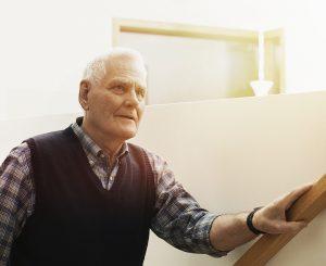 Senior man wearing a smart care watch